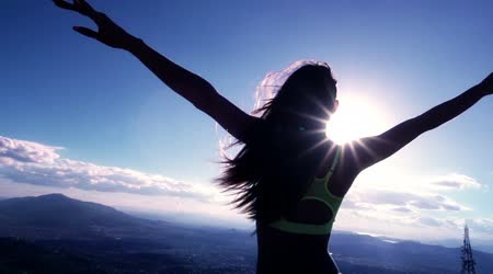 depositphotos_45592167-stock-video-silhouetted-woman-at-the-mountaintop